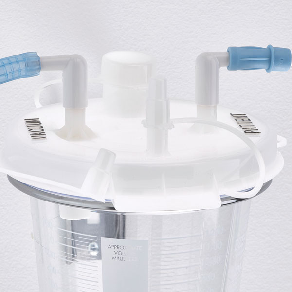 4. Connect patient tubing to patient port elbow on lid. Cap all ports not in use.