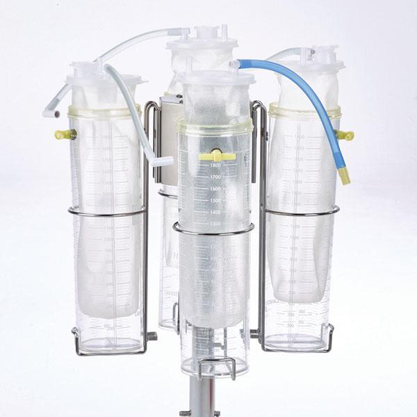 3. Inserte tubos de revestimiento del mismo tamaño (1 tubo con VAC-GARD® y los demás tubos sin VAC-GARD®) y asegure las tapas de los tubos revestimiento a los recipientes.