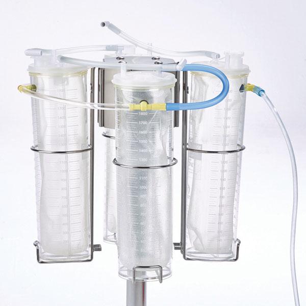 """4. Interconecte el recipiente en """"T"""" con el tubo de vacío. Conecte el tubo azul VAC-GARD® de la tapa y el tubo de vacío a los puertos en """"T"""" abiertos restantes."""