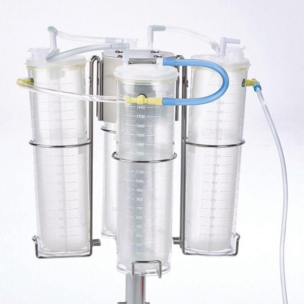 5. Conecte el tubo en tándem de la tapa (claro) al puerto del paciente de la tapa con el tubo azul. Repita el proceso hasta que todos los tubos de revestimiento estén conectados.